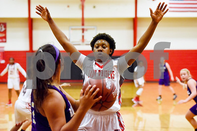 Robert E. Lee senior Ja'Kayla Bowie (15) raises her hands to block a pass during a high school basketball game at Robert E. Lee High School in Tyler, Texas, on Tuesday, Nov. 14, 2017. (Chelsea Purgahn/Tyler Morning Telegraph)