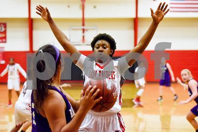 Robert E. Lee senior Ja'Kayla Bowie (15) raises her hands to block a pass during a high school basketball game at Robert E. Lee High School in Tyler, Texas, on Tuesday, Nov. 14, 2017. (Chelsea Purgahn/Tyler Morning Telegraph)