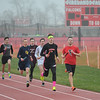 Runners compete in a relay during the Nelson Howe Invitational at Firelands High School. Eric Bonzar — The Morning Journal