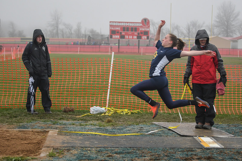 Olmsted Falls' Colleen Thiel competes in the long jump during the Nelson Howe Invitational at Firelands High School. Eric Bonzar — The Morning Journal