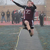 Wellington's Parker Adler competes in the long jump during the Nelson Howe Invitational . Eric Bonzar — The Morning Journal