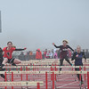 Runners compete in the girls 110-meter hurdles. Eric Bonzar — The Morning Journal