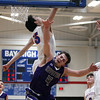 Bay's RJ Sunahara blocks the shot by Brody Kuhl of Keystone during the third quarter. Randy Meyers -- The Morning Journal