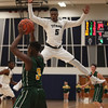Lorain's Daesean Brooks applies full court pressure on Jaiden Sledge of Amherst during the second quarter. Randy Meyers -- The Morning Journal