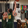Lorain's Naz Bohannon drives past Chad Jones and Carter Zajkowski of Amherst during the second quarter. Randy Meyers -- The Morning Journal