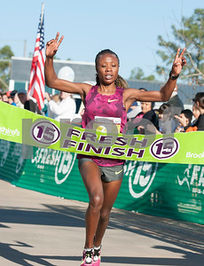 The first place female runner Veronica Maina crosses the finish line during the Fresh 15 15k race Saturday March 5, 2016 in Tyler.  (Sarah A. Miller/Tyler Morning Telegraph)
