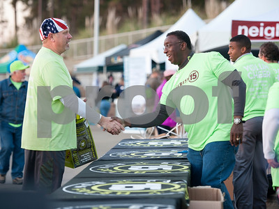 Kelly Smith of Tyler shakes hands with Terrence Dixon before the Fresh 15 race Saturday March 5, 2016 in Tyler.   (Sarah A. Miller/Tyler Morning Telegraph)