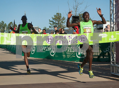 The first place (at right) and second place (at left) runners cross the finish line in just over 44 minutes during the Fresh 15 15k race Saturday March 5, 2016 in Tyler.  (Sarah A. Miller/Tyler Morning Telegraph)