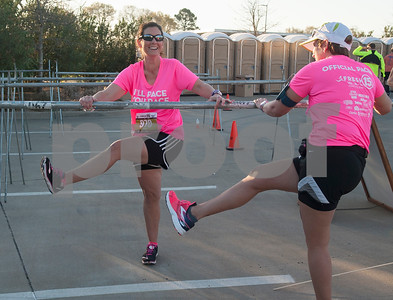Officer pace runners Amie Height of Tyler and Dana Dudley of Tyler warm up before the start of the Fresh 15 15k race Saturday March 5, 2016 in Tyler.   (Sarah A. Miller/Tyler Morning Telegraph)