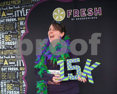 Stephanie Herrington of Chandler takes a photo at the photo booth before running the Fresh 15 15k race Saturday March 5, 2016 in Tyler.   (Sarah A. Miller/Tyler Morning Telegraph)