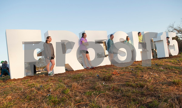 A group of friends take a photo with a large Fresh 15 sign before the start of the 15k race Saturday March 5, 2016 in Tyler. Pictured from left: Lauren Wilson of Dallas, Joanna Calhoun on Katy, Sam Victor of Lexington, Kentucky, Tabitha Whitacre of Louisville, Kentucky, Cassie Holbert of Tyler and Mackenzie Herring of Dallas.  (Sarah A. Miller/Tyler Morning Telegraph)