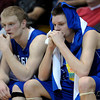 Broomfield's Dan Perse (left) and Spencer Reeb (right) sit stunned as the they loose to Sierra in their semi-final basketball game at the University of Colorado in Boulder, Colorado March 8, 2012. CAMERA/MARK LEFFINGWELL