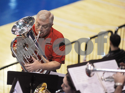 photo by Sarah A. Miller/Tyler Morning Telegraph  Trinity Valley Community College Cardinal Regiment Pep Band director Lee Hudson plays the baritone during a time out at the women's basketball game Friday at UT Tyler's Patriot Center. Trinity Valley is advancing to the Region XIV Basketball Championship game Saturday at 3p.m.