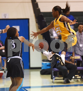 Tyler Junior College's Antionette Shrepee jumps trying to block Blinn College's Ke'Asia Williams during their game in the Region XIV Basketball Tournament held Wednesday March 8, 2017 at John Alexander Gym in Jacksonville.  (Sarah A. Miller/Tyler Morning Telegraph)