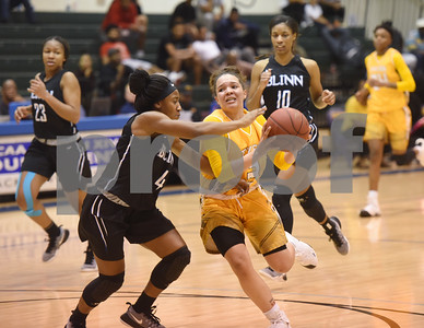 Tyler Junior College's Jordan Towery maneuvers around Blinn College's Alexis Oaks during their game in the Region XIV Basketball Tournament held Wednesday March 8, 2017 at John Alexander Gym in Jacksonville.  (Sarah A. Miller/Tyler Morning Telegraph)