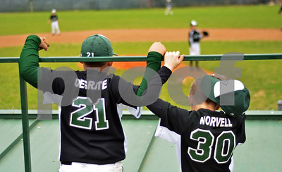 Players of Tyler's Diamond Jaxx watch from behind the dugout, waiting for their game. (Victor Texcucano)