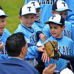 Rockwall Heath Texans coach Alex Hoover motivates his team between innings on Saturday afternoon at the Strike Out Cancer for Make-A-Wish Foundation tournament at Faulkner Park. (Victor Texcucano)