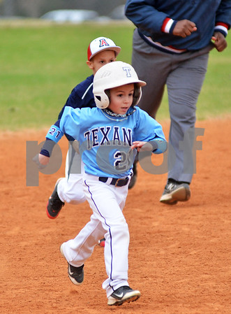 Dylan Ray, 7, of the Rockwall Heath Texans attempts to take third base. (Victor Texcucano)