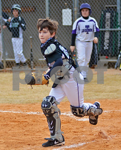 Nate Noland, 9, of the Tyler Diamond Jaxx looks to third base before making a throw on Saturday afternoon at the Strike Out Cancer for Make-A-Wish Foundation tournament at Faulkner Park. (Victor Texcucano)