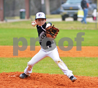 Cooper Hill, 9, of the Tyler Diamond Jaxx delivers a pitch on Saturday afternoon at the Strike Out Cancer for Make-A-Wish Foundation tournament at Faulkner Park. (Victor Texcucano)