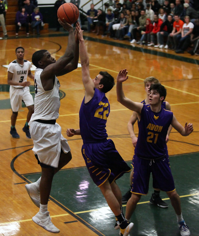 . Naz Bohannon of Lorain shoots and scores over Ryan Bertrand of Avon during the third quarter. Randy Meyers -- The Morning Journal