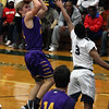 Avon's Ryan Maloy shoots a jumper over Shayne Smith of Lorain during the second quarter. Randy Meyers -- The Morning Journal