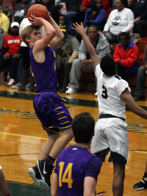 . Avon\'s Ryan Maloy shoots a jumper over Shayne Smith of Lorain during the second quarter. Randy Meyers -- The Morning Journal