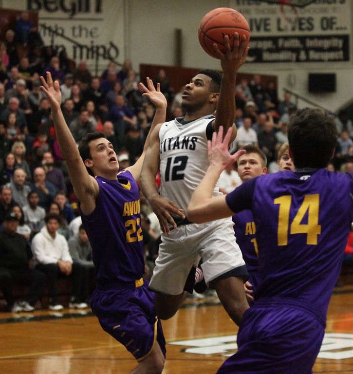 . Lorain\'s Jalil Little drives in the lane and shoots over Ryan Bertrand of Avon during the first quarter. Randy Meyers -- The Morning Journal