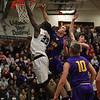 Lorain's Naz Bohannon drives past Ryan Bertrand and Jake Parker of Avon for a lay up at the rim during the first quarte. Randy Meyers -- The Morning Journal