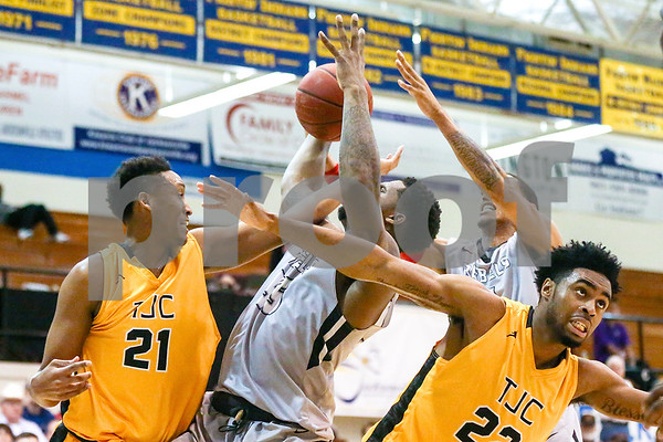 Lee College and Tyler Junior College players reach for the ball during a Region XIV tournament game at John Alexander Gym in Jacksonville, Texas, on Thursday, March 9, 2017. Lee College won 70-69. (Chelsea Purgahn/Tyler Morning Telegraph)