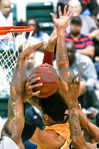 Lee College players block a Tyler Junior College player's shot during a NJCAA Region XIV tournament game at John Alexander Gym in Jacksonville, Texas, on Thursday, March 9, 2017. Lee College won 70-69. (Chelsea Purgahn/Tyler Morning Telegraph)