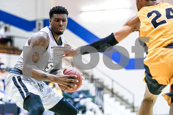 Lee College sophomore Tony Farmer (55) holds the ball during a NJCAA Region XIV tournament game at John Alexander Gym in Jacksonville, Texas, on Thursday, March 9, 2017. Lee College won 70-69. (Chelsea Purgahn/Tyler Morning Telegraph)