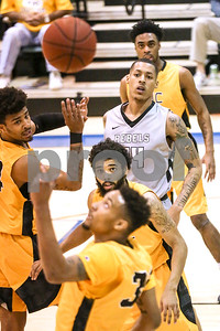 Tyler Junior College and Lee College players look towards the ball in the air during a NJCAA Region XIV tournament game at John Alexander Gym in Jacksonville, Texas, on Thursday, March 9, 2017. Lee College won 70-69. (Chelsea Purgahn/Tyler Morning Telegraph)