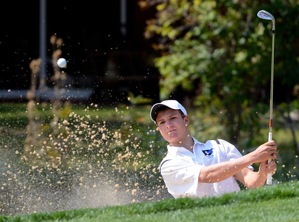 Cam Connor of Alexander Dawson hits out of a sand trap at the Class 3A Northern Regional Golf Tournament at the Boulder Country Cluf on Thursday September 20, 2012. <br /> Photo by Paul Aiken