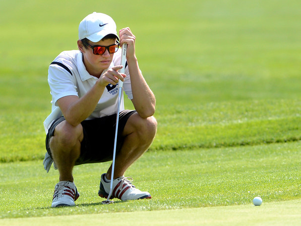 Carson Jones of Alexander Dawson lines up a putt at the Class 3A Northern Regional Golf Tournament at the Boulder Country Cluf on Thursday September 20, 2012. <br /> Photo by Paul Aiken