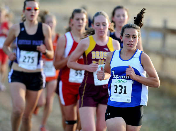 Melissa Roberts (331) of Lyons wins the 3A regional on Thursday.<br /> The regional 3A/4A cross country races were held at Lyons High School.<br /> Cliff Grassmick / October 22, 2009