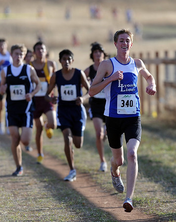 Dylan Donohoe (340), right,  of Lyons finished second in the 3A regional on Thursday.<br /> The regional 3A/4A cross country races were held at Lyons High School.<br /> Cliff Grassmick / October 22, 2009