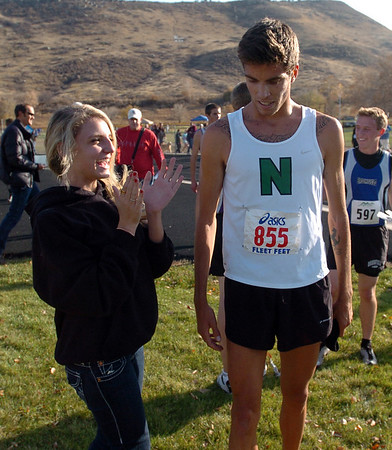 Olivia Perry, twin sister of David, claps for him after he won the  4A race on Thursday.<br /> The regional 3A/4A cross country races were held at Lyons High School.<br /> Cliff Grassmick / October 22, 2009