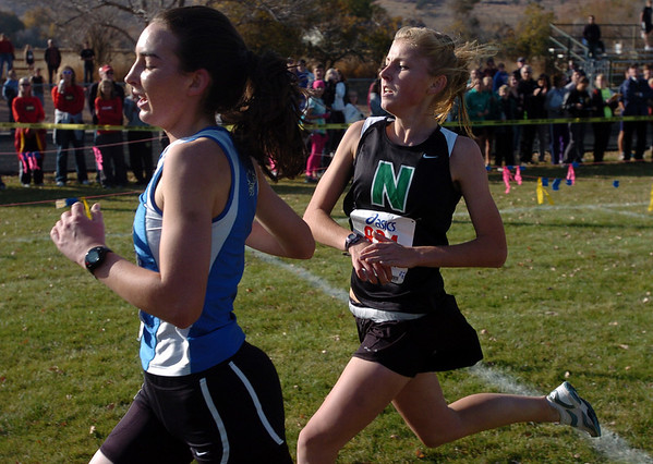 Jill Carlson, left,  of Broomfield, finishes 4th, and Kaiti Shepherd of Niwot finishes 5th in the 4A regional on Thursday.<br /> The regional 3A/4A cross country races were held at Lyons High School.<br /> Cliff Grassmick / October 22, 2009