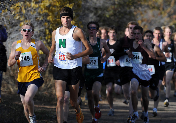 David Perry,  second from the left, of Niwot is in the lead of the 4A race. Perry went on to win.<br /> The regional 3A/4A cross country races were held at Lyons High School.<br /> Cliff Grassmick / October 22, 2009
