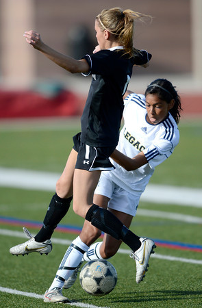 Legacy's Jesse Parra (right) keeps the ball from Monarch's Brenna Stimac (left) during their soccer game in Westminster, Colorado April 10, 2012. CAMERA/MARK LEFFINGWELL