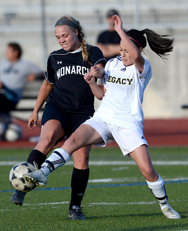 Legacy's Jacey Coniff (right) kicks the ball away from Monarch's Gina Ogg (left) during their soccer game in Westminster, Colorado April 10, 2012. CAMERA/MARK LEFFINGWELL