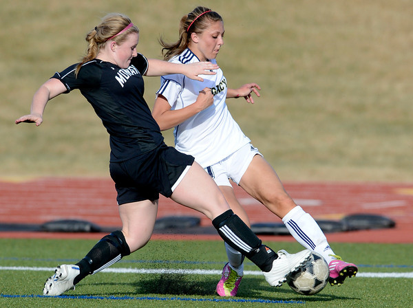Monarch's Megan Lacy (left) steals the ball from Legacy's Kelsey Killean (right) during their soccer game in Westminster, Colorado April 10, 2012. CAMERA/MARK LEFFINGWELL