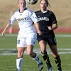 Legacy's Kellie Drobney (left) blocks Monarch's Cassie Owens (right) from the ball during their soccer game in Westminster, Colorado April 10, 2012. CAMERA/MARK LEFFINGWELL