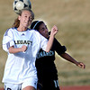 Legacy's Jenna Humphrey (left) heads the ball away from Monarch's Jimena Mohedas (right) during their soccer game in Westminster, Colorado April 10, 2012. CAMERA/MARK LEFFINGWELL