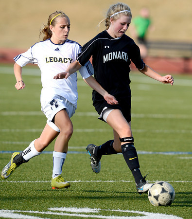 Legacy's Michaela Vadeboncoeur (left) and Monarch's Meghan Tenge (right) race for the ball during their soccer game in Westminster, Colorado April 10, 2012. CAMERA/MARK LEFFINGWELL