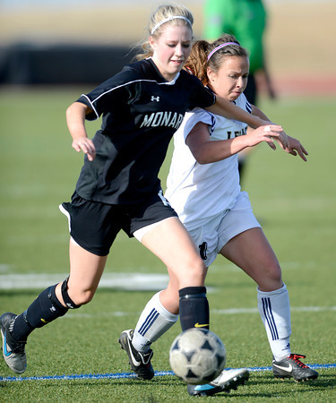 Monarch's Meghan Tenge (left) races Legacy's Jessie Arellano (right) for the ball during their soccer game in Westminster, Colorado April 10, 2012. CAMERA/MARK LEFFINGWELL