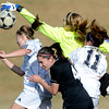Monarch's goaltender Mae Williams (top right) and Nicole Barbour (middle left) defend against Legacy's Kelsey Killean (left) and Jessie Arellano (right) during their soccer game in Westminster, Colorado April 10, 2012. CAMERA/MARK LEFFINGWELL