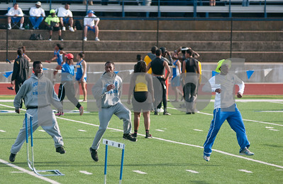 photo by Sarah A. Miller/Tyler Morning Telegraph  John Tyler High School track team members warm up on the field during the District 16-4A track meet at Lindale High School's Eagle Stadium Thursday.