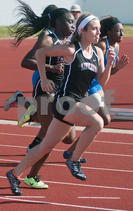 photo by Sarah A. Miller/Tyler Morning Telegraph  Whitehouse sophomore Brooke Smith runs in the varsity sprint relays during the District 16-4A track meet at Lindale High School's Eagle Stadium Thursday.